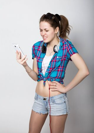 woman dialing phone number: teenager girl talking on mobile phone and express different emotions Stock Photo