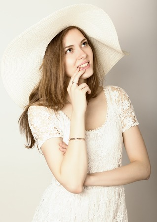 dreaminess: beautiful girl in broad-brimmed hat posing and expresses different emotions. dreaminess.