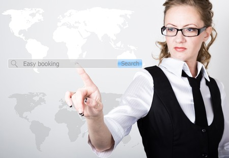 hotel reviews: Easy booking written in search bar on virtual screen. technology, internet and networking concept. Internet technologies in business and home. woman in business suit and tie, presses a finger on a virtual screen.
