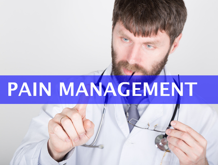 pain management: technology, internet and networking in medicine concept - medical doctor presses pain management button on virtual screens. Internet technologies in medicine.