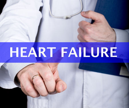 heart failure: technology, internet and networking in medicine concept - medical doctor presses heart failure button on virtual screens. Internet technologies in medicine. Stock Photo