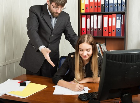 superiors: relations between superiors and subordinates. Angry boss screaming to his employer woman and she is surprised and shocked.