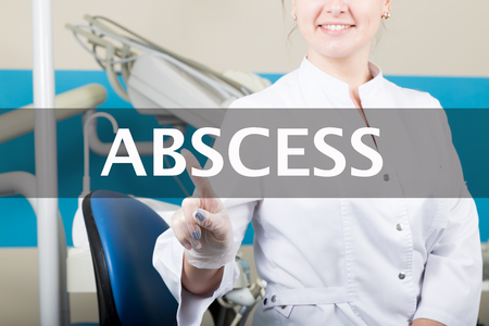 abscess: technology, internet and networking in medicine concept - medical doctor presses abscess button on virtual screens. Internet technologies in medicine.