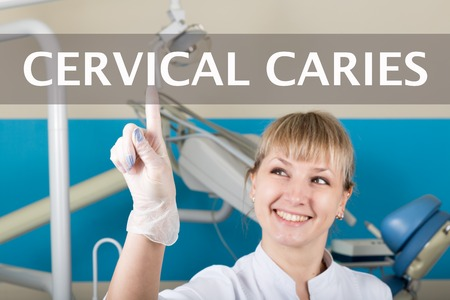 dental calculus: technology, internet and networking in medicine concept - medical doctor presses cervical caries button on virtual screens. Internet technologies in medicine. Stock Photo