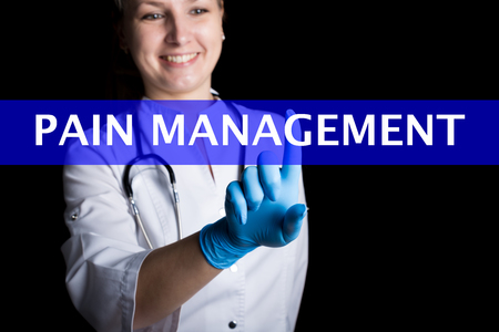 pain management: Internet and technology concept. smiling female doctor presses a finger on a virtual screen. pain management written on a virtual panel. Internet technologies in medicine.