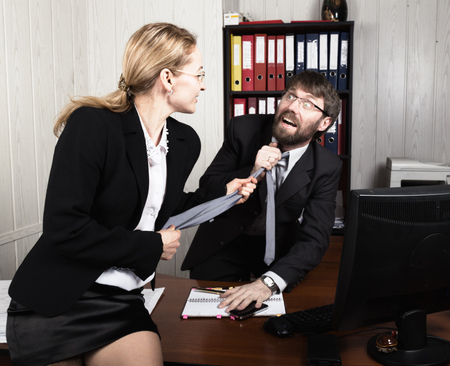 sexual relations: Sexual harassment. female boss sexually molested the male employee. Stock Photo