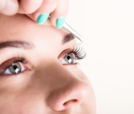 Beautiful young woman eyelash extension. Woman eye with long eyelashes. Beauty salon concept.