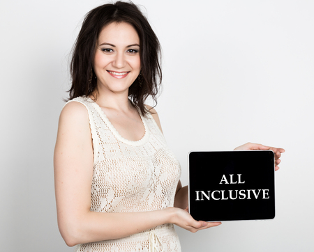 inclusive: technology, internet and networking - close-up successful woman holding a tablet pc with all inclusive sign. internet technology in tourism. Stock Photo