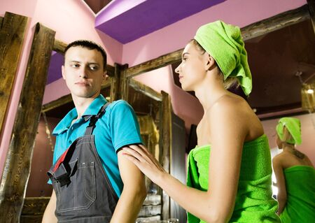 vision repair: Plumber having flirt with young girl at home. men with young female customer before flirt. Stock Photo