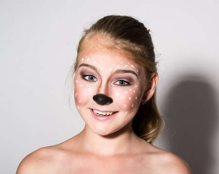 expresses: Beautiful girl with funny make-up, expresses different emotions. Funny image of beautiful pretty girl.