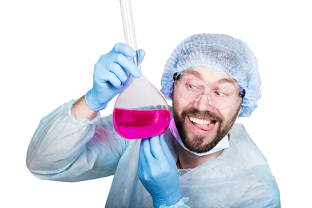 experimenting: Funny crazy emotional chemist with flask. mad scientist in his laboratory experimenting on secret formulas Stock Photo