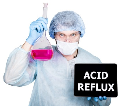 acid reflux: Doctor in surgical uniform, holding flask and digital tablet pc with acid reflux sign. technology, internet and networking in medicine concept. Isolated on white