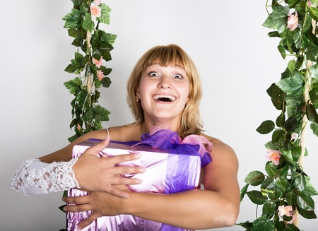 expresses: young beautiful bride holding wedding gifts and expresses different emotions.