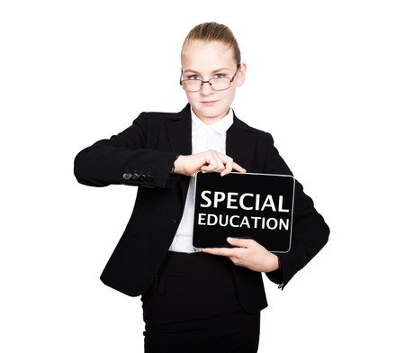 special education: school girl in a business suit holds a pc tablet in his hands with inscription special education.