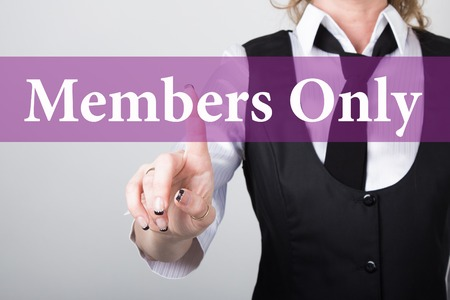 only members: members only written on virtual screen. technology, internet and networking concept. woman in a black business shirt presses button on virtual screens. Stock Photo