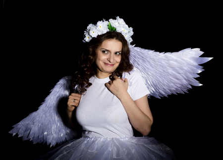 Portrait of beautiful woman with angels wings.