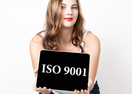 ISO 9001 written on virtual screen. technology, internet and networking concept. beautiful woman with bare shoulders holding pc tablet.