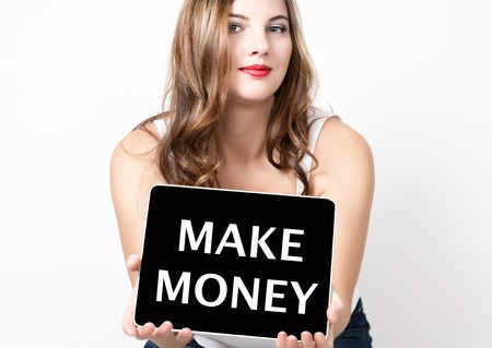 make money written on virtual screen. technology, internet and networking concept. beautiful woman with bare shoulders holding pc tablet.