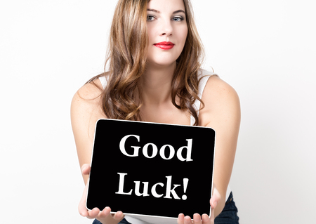 good luck written on virtual screen. technology, internet and networking concept. beautiful woman with bare shoulders holding pc tablet.