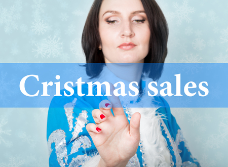 cristmas: cristmas sale written on virtual screen. concept of celebratory technology in internet and networking. woman in cristmas uniform presses button on virtual screens.