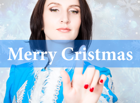 merry cristmas written on virtual screen. concept of celebratory technology in internet and networking. woman in cristmas uniform presses button on virtual screens.