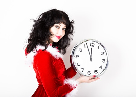 young beautiful woman in red coat holding big clock. time concept