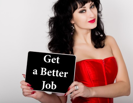red corset: get a better job written on virtual screen. technology, internet and networking concept. sexy woman in a red corset holding pc tablet.