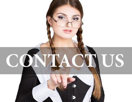 contact us written on virtual screen. sexy secretary in a business suit with glasses, presses button on virtual screens. technology, internet and networking concept. Stock Photo