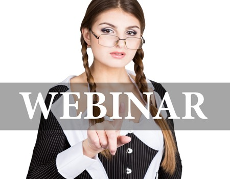 webinar written on virtual screen. sexy secretary in a business suit with glasses, presses button on virtual screens. technology, internet and networking concept.