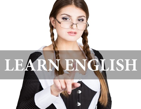 learn english written on virtual screen. sexy secretary in a business suit with glasses, presses button on virtual screens. technology, internet and networking concept. Stock Photo