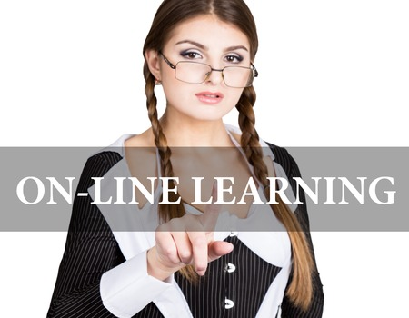 on-line learning written on virtual screen. sexy secretary in a business suit with glasses, presses button on virtual screens. technology, internet and networking concept. Stock Photo