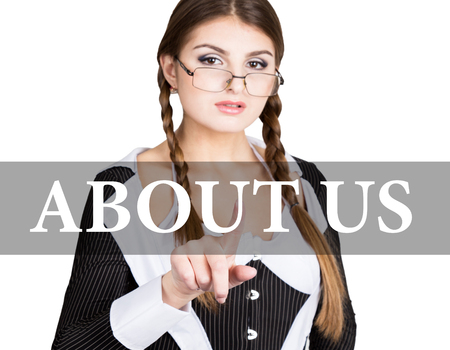 about us written on virtual screen. sexy secretary in a business suit with glasses, presses button on virtual screens. technology, internet and networking concept. Stock Photo