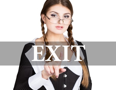 exit written on virtual screen. sexy secretary in a business suit with glasses, presses button on virtual screens. technology, internet and networking concept. Stock Photo