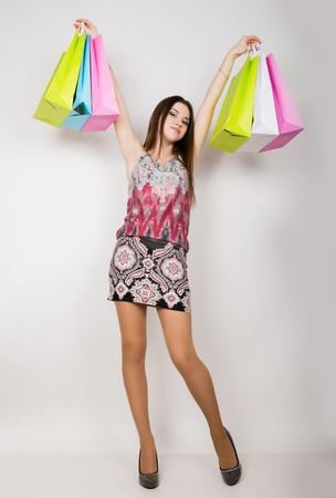 elegance fashion girls look sensuality young: happy young woman posing with shopping bags Stock Photo
