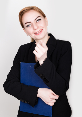 Attractive and energetic business woman holding pad for writing