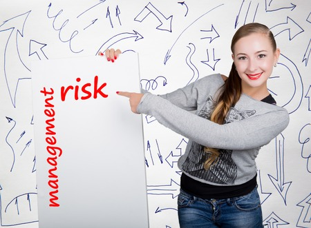 Young woman holding whiteboard with writing word: risk management. Technology, internet, business and marketing.