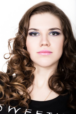 sugarplum: Young beautiful curly girl with professional make-up Stock Photo
