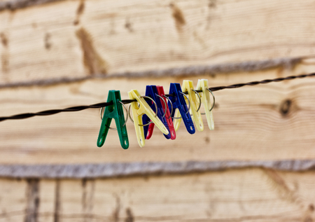 plastic clothes pins on a rope, nature background