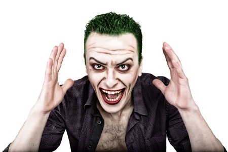 psychotic: guy with crazy joker face, green hair and idiotic smike. carnaval costume