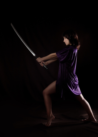 beautiful sexy woman with samurai sword. sexy woman with katana