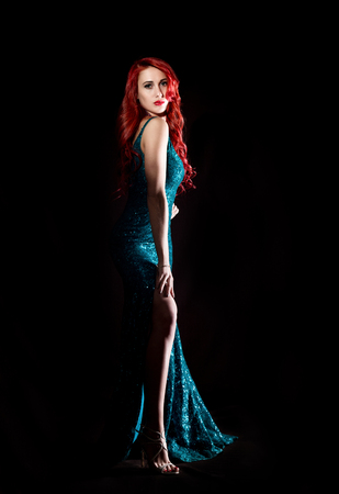 adult sex: Young redhead sexy woman in blue elegant dress poses in a dark