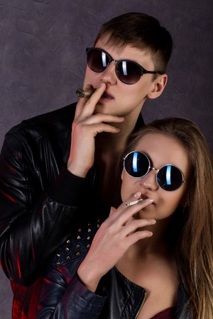 adult sex: Expressive beautiful girl and handsome guy smoking cigarette before passionate night. Stock Photo