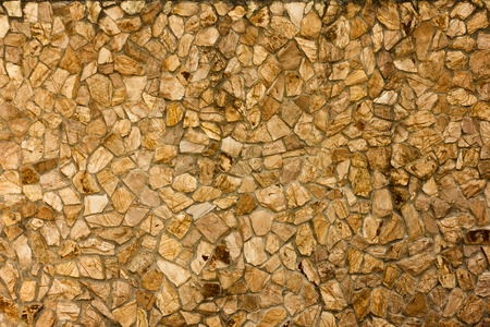 part of a stone wall, brownish beige tones for background or texture.