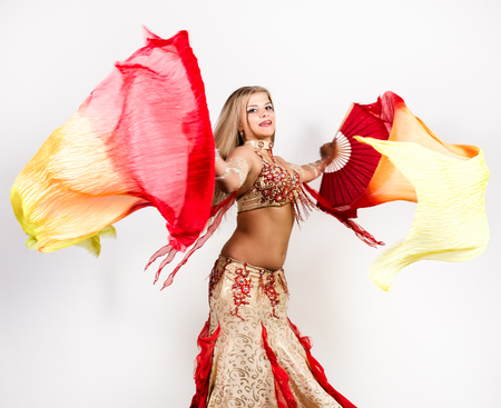 Arabic dance with fans and ribbons performed by a beautiful plump woman Stock Photo