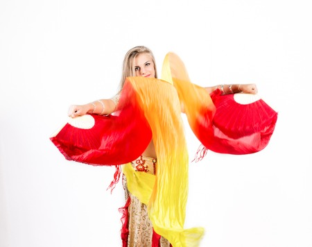 Arabic dance with fans and ribbons performed by a beautiful plump woman Stock Photo - 85821116