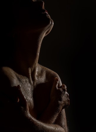 sexy nude female neck and shoulders with water drops on a black background. Stock Photo