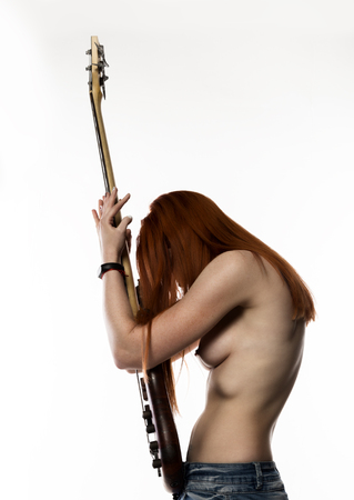 sexy nude rock woman playing on electric guitar on a white background