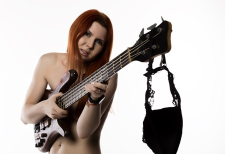 sexy nude rock woman playing on electric guitar on a white background. Stock Photo