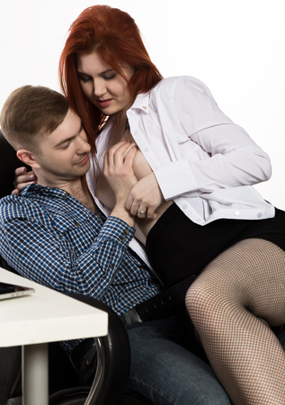 young sexy secretary is sexually harassing to her boss. love affair at work 스톡 콘텐츠