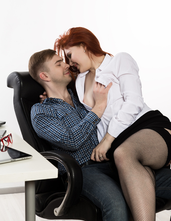 young sexy secretary is sexually harassing to her boss. love affair at work Reklamní fotografie